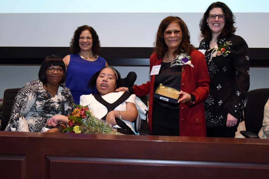 Woman and family receives award